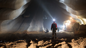 An employee uses the light from a head torch to illuminate the machine cut walls of a potash mine operated by OAO Uralkali in Berezniki, Russia, on Friday, Aug. 23, 2013. Russia pressured Belarus to free Vladislav Baumgertner, the head of OAO Uralkali, the world's biggest potash producer, saying a refusal may harm relations as the smaller nation faces a funding crunch. Photographer: Andrey Rudakov/Bloomberg via Getty Images